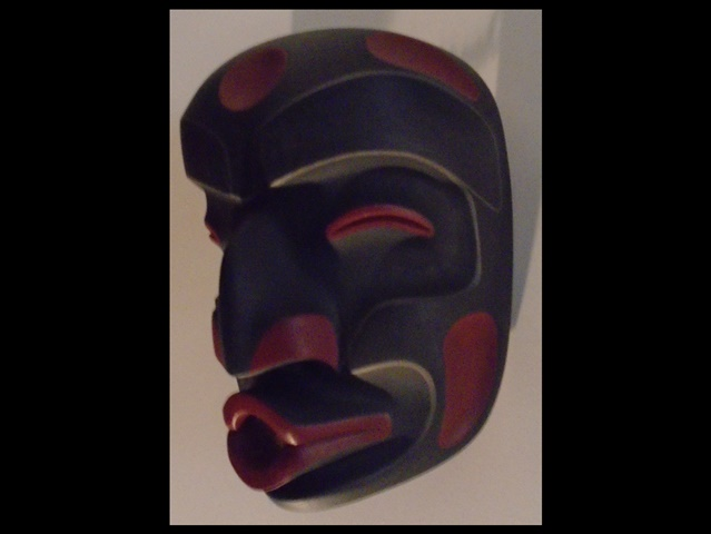 "2. Dzunakwa Mask, 9"" high, red cedar & acrylic"