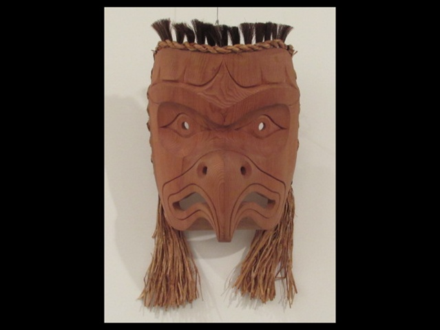 "7. Eagle Mask, 12"" high, red cedar, horse hair, cedar rope"