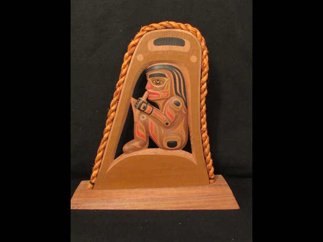 8. Halibut Fisherman; 2' high; red cedar, acrylic, cedar rope