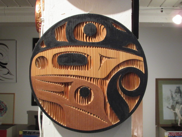 Raven Panel; 1' diameter; red cedar, acrylic
